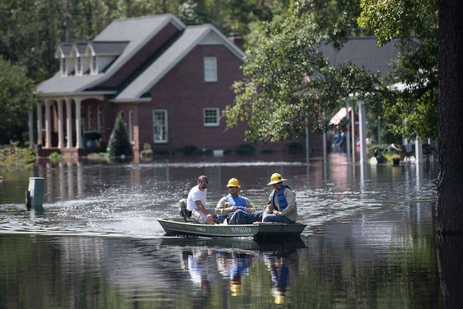 People navigate floodwaters caused by Hurricane Florence near the Waccamaw River on Sept. 23 in Conway, South Carolina. Floodwaters were expected to continue to rise in Conway. Photo: Sean Rayford /Getty Images / 2018 Getty Images