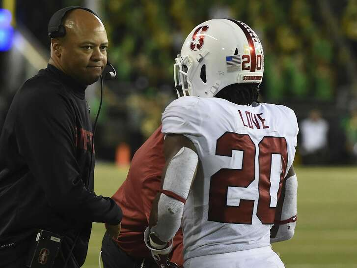 EUGENE, OR - SEPTEMBER 22: Head coach David Shaw greets running back Bryce Love (20) of the Stanford Cardinal after Love scored a touchdown in the third quarter of the game against the Oregon Ducks at Autzen Stadium on September 22, 2018 in Eugene, Oregon. Stanford won the game in overtime 38-31.  (Photo by Steve Dykes/Getty Images)