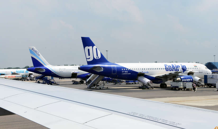 FILE -- The picture featuring planes of various airlines parked at the IGI airport on July 25, 2013 in New Delhi, India. A passenger mistakenly attempted to open the plane's exit door when looking for a bathroom. Photo: (Photo By Ramesh Pathania/Mint Via Getty Images)
