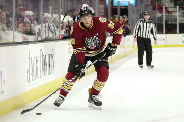 Chicago Wolves defenseman Chris Casto plays the puck against the Cleveland Monsters on Dec. 9.