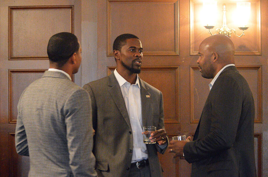SIUE men's basketball coach Jon Harris, center, relaxes before taking part in a luncheon at the Missouri Athletic Club. Photo: Scott Marion