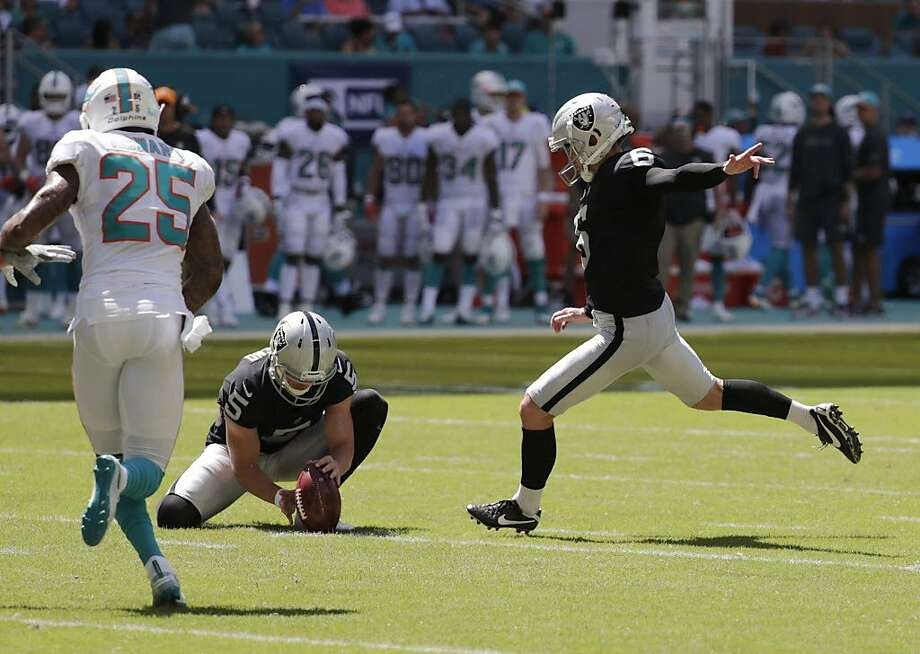 Oakland Raiders kicker Mike Nugent (6) boots a field goal as punter Johnny Townsend (5) holds while being rushed by Miami Dolphins cornerback Xavien Howard (25) during the first half of an NFL football game, Sunday, Sept. 23, 2018, in Miami Gardens, Fla. (AP Photo/Lynne Sladky) Photo: Lynne Sladky / Associated Press