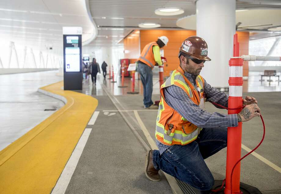 Crews cordon off a section of the third-level bus terminal inside the Transbay Transit Center after a major crack was reported in a steel beam. Buses were rerouted to the temporary terminal used during construction. Photo: Jessica Christian / The Chronicle
