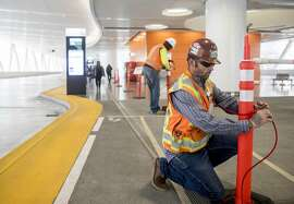 Construction crews corona off a section of the third-level bus terminal inside Transbay Terminal in San Francisco, Calif. Tuesday, Sept. 25, 2018 after an apparent crack was reported in a steel beam.