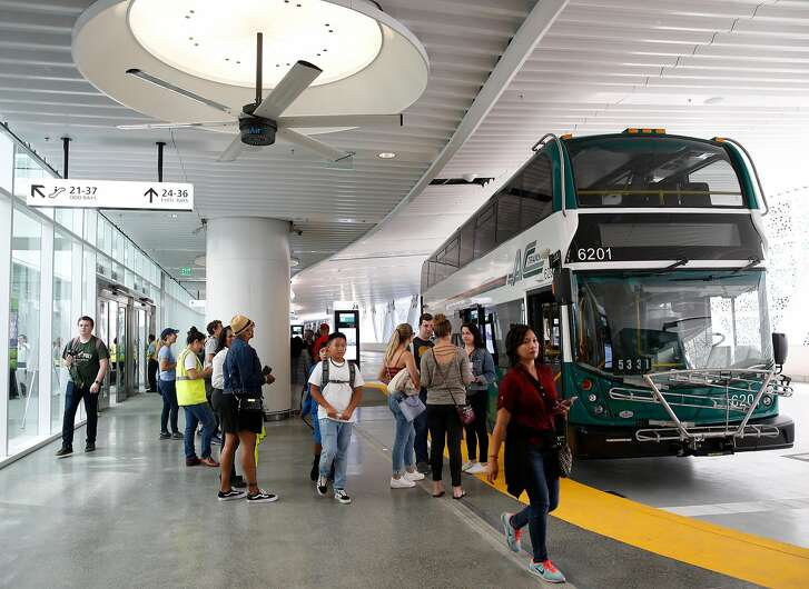 AC Transit displays a new double decker bus for visitors to tour at the grand opening of the Salesforce Transit Center in San Francisco, Calif. on Saturday, Aug. 11, 2018. Buses begin rolling through the terminal Sunday.