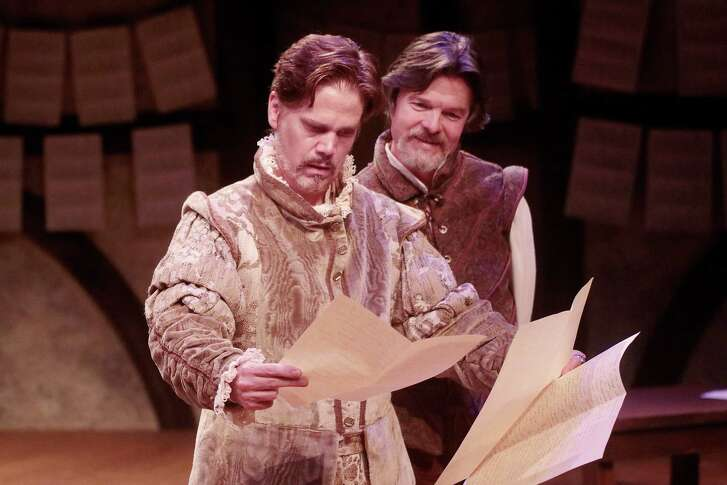 """Dwight Clark and Joel Sandel and actors examining Shakespeare's works in Main Street Theater's """"The Book of Will."""""""