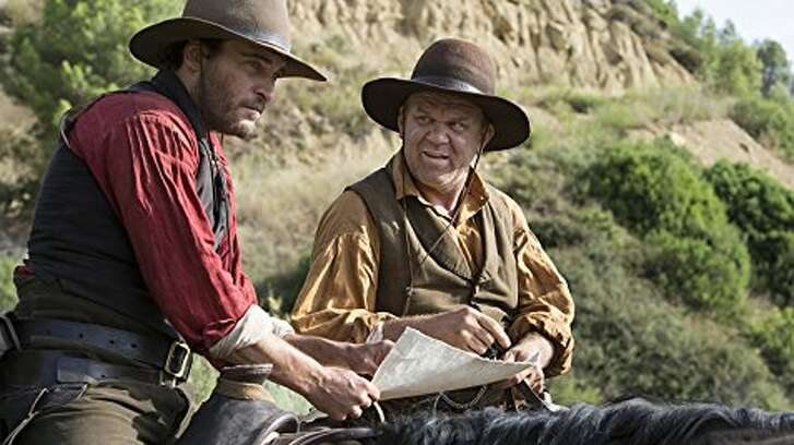 """Joaquin Phoenix and John C. Reilly in a scene from the film """"The Sisters Brothers."""""""