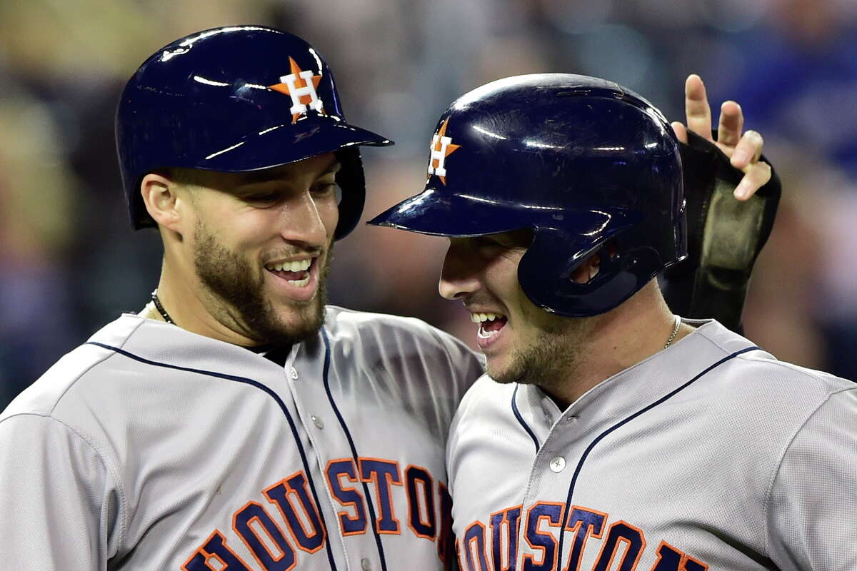 Houston Astros' Alex Bregman, right, celebrates his two-run home run with George Springer during the first inning of a baseball game against the Toronto Blue Jays on Tuesday, Sept. 25, 2018, in Toronto. (Frank Gunn/The Canadian Press via AP)