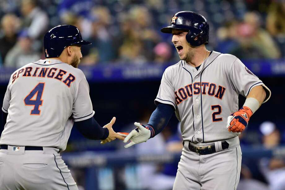 Houston Astros' Alex Bregman (2) celebrates his two-run home run with George Springer (4) during the first inning of a baseball game against the Toronto Blue Jays on Tuesday, Sept. 25, 2018, in Toronto. (Frank Gunn/The Canadian Press via AP) Photo: Frank Gunn, Associated Press / The Canadian Press