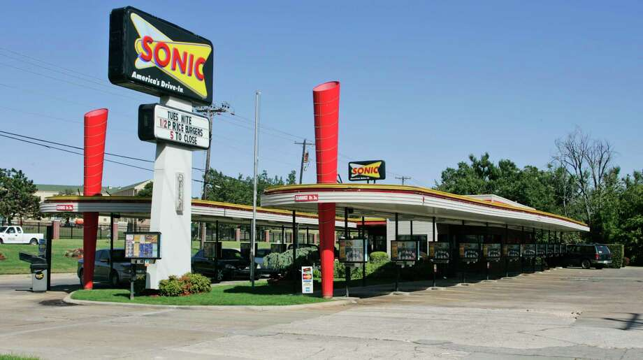FILE- In this Oct. 1, 2008, file photo a Sonic restaurant is pictured in Oklahoma City. Arby's owner Inspire Brands is buying the Sonic drive-in hamburger chain. Inspire said Tuesday, Sept. 25, 2018, that owning multiple chains will help it share resources, including customer loyalty data and suppliers. (AP Photo/Sue Ogrocki, File) Photo: Sue Ogrocki / AP2008