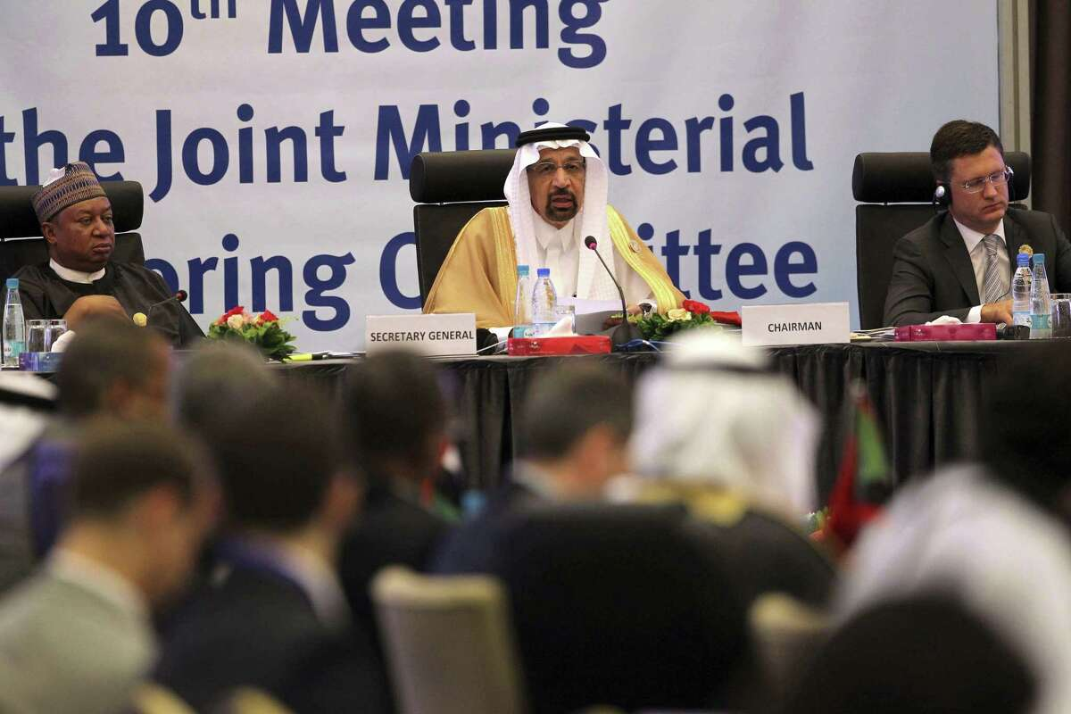 Khalid Al-Falih Minister of Energy, Industry and Mineral Resources of Saudi Arabia, center, speaks during OPEC's 10th meeting of the Joint Ministerial Committee to monitor the oil production reduction agreement of the Organization of the Petroleum Exporting Countries, OPEC, and non-OPEC members, in Algiers, Algeria, Sunday, Sept. 23, 2018. (AP Photo/Anis Belghoul)
