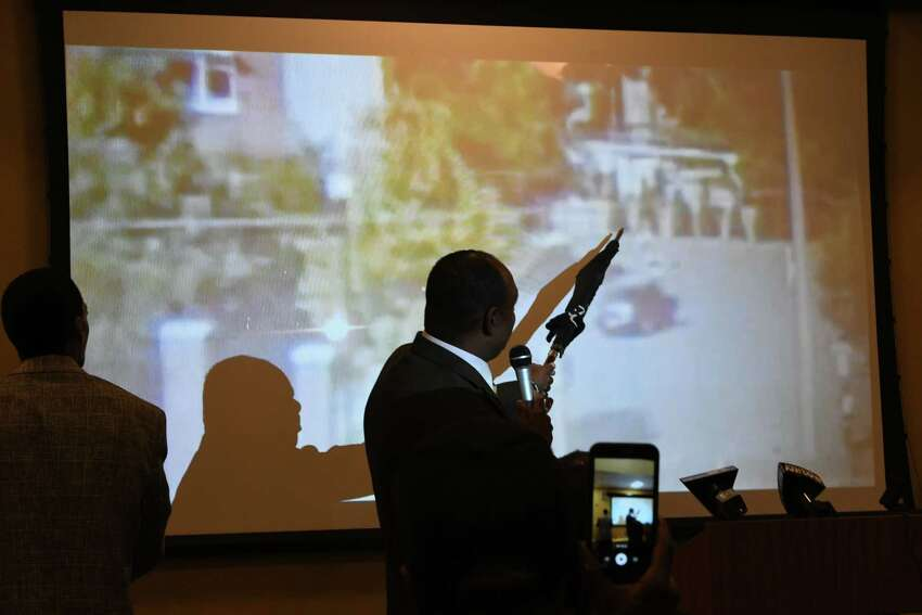 Anthony Muhammad, Albany NY Rep. of The Hon. Minister Louis Farrakkan, points to video of the shooting of Ellazar Williams as a group of Religious, Political, and Grassroot organizations hold a Justice or Else! rally/power point presentation for Ellazar Williams at the Albany Public Library on Henry Johnson Blvd. on Tuesday, Sept. 25, 2018 in Albany, N.Y. Ellazar Williams was shot in the back by an Albany Police Detective. (Lori Van Buren/Times Union)
