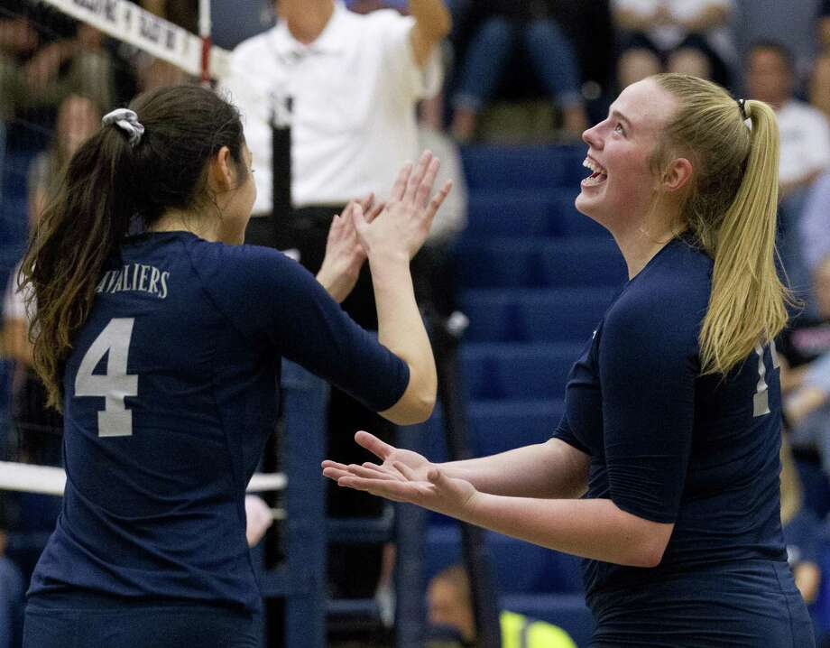 College Park's Annie Cooke (14) laughs beside Kamryn Hernandez (4) during the first set of a District 15-6A high school volleyball game at College Park High School, Tuesday, Sept. 25, 2018, in The Woodlands. Photo: Jason Fochtman, Houston Chronicle / Staff Photographer / © 2018 Houston Chronicle