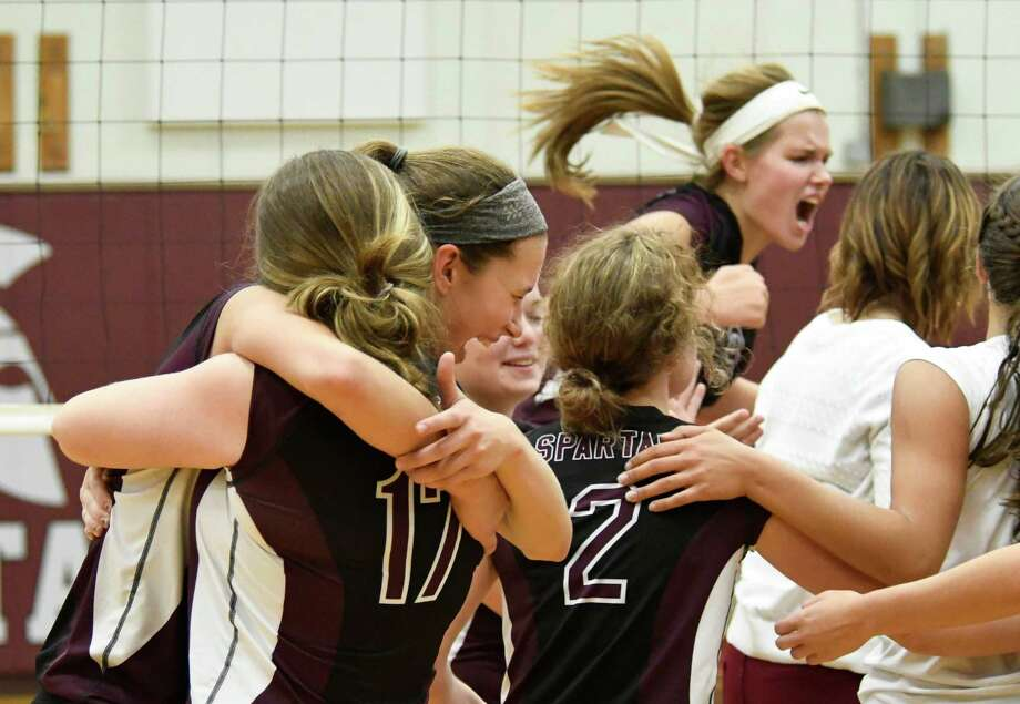 Burnt Hills volleyball players react to their victory over Shenendehowa during a game on Tuesday, Sept. 25, 2018, in Burnt Hills, N.Y. (Jenn March, Special to the Post-Star) Photo: Jenn March, Jenn March Photography / © Albany Times Union 2018 © Jenn March 2018