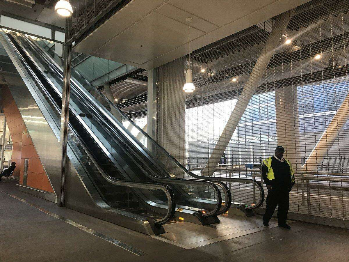 Officials block the escalators at the Salesforce Transit Center after a crack was found in a steel beam, resulting in closure of the terminal.