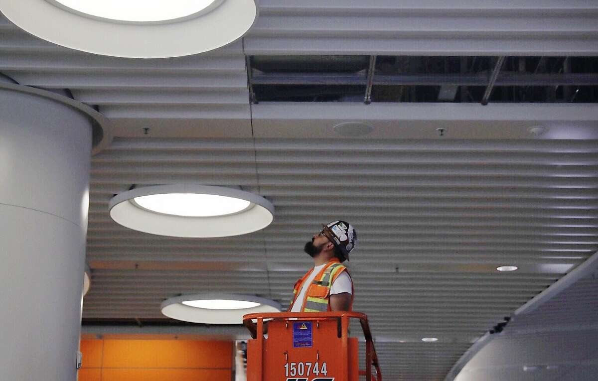 A construction worker inspects a portion of the roof inside Transbay Terminal�s third-level bus terminal after reports of a crack in a steel beam at the Transbay Terminal near Fremont and Mission streets in San Francisco, Calif. Tuesday, September 25, 2018.