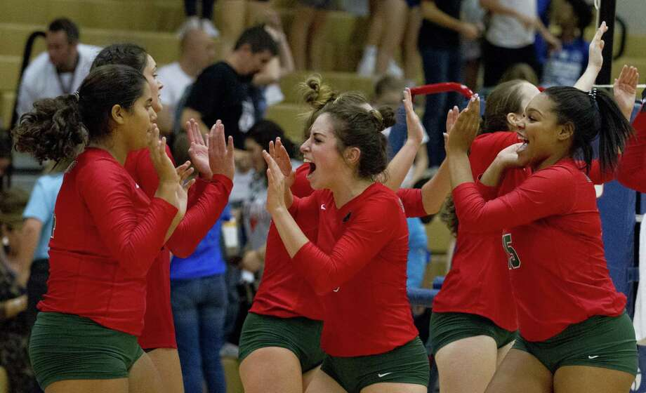 The Woodlands' Bailey Weidemeyer (3) reacts with teammates after defeating Oak Ridge in five sets during a District 15-6A high school volleyball game at Oak Ridge High School, Tuesday, Sept. 25, 2018, in Shenandoah. Photo: Jason Fochtman, Houston Chronicle / Staff Photographer / © 2018 Houston Chronicle