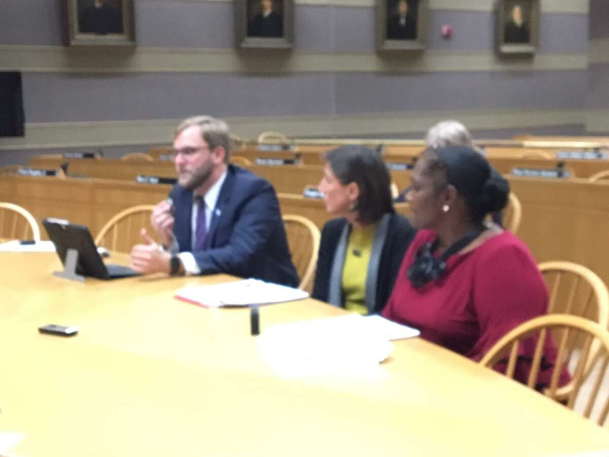 From left, Doug Hausladen, acting director of the Parking Authority, Dara Kovel, president of Beacon Development and Serena Neal-Sanjurjo, head of the Livable City Initiative, testify on a deal to save the Ninth Square.