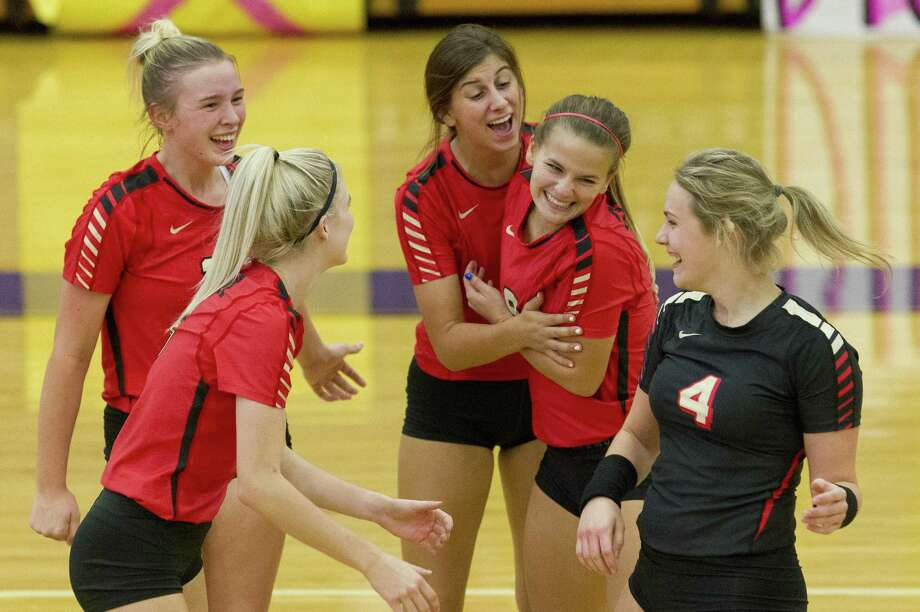 In this file photo, Caney Creek players react after scoring a point during the third set of a District 20-5A high school volleyball game at Montgomery High School, Tuesday, Sept. 18, 2018, in Montgomery. Photo: Jason Fochtman, Houston Chronicle / Staff Photographer / © 2018 Houston Chronicle