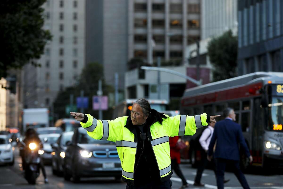 A San Francisco police officer directs traffic at Beale and Howard after the closure of the SalesForce Transit Center in San Francisco, Calif., on Tuesday, September 25, 2018.