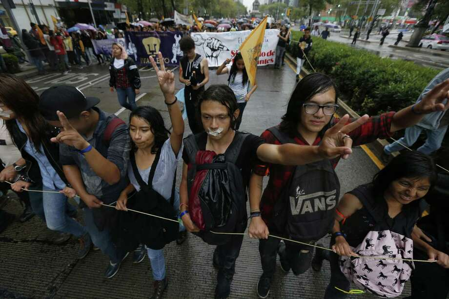 "Thousands of students take part in the march for silence, in protest against groups of institutional thugs that operate on campus at Mexico's National Autonomous University, UNAM, in Mexico City, Thursday, Sept. 13, 2018. The students are demanding an end to violence by groups of thugs known as ""porros"" who are often registered but don't attend classes. (AP Photo/Marco Ugarte) Photo: Marco Ugarte /Associated Press / Copyright 2018 The Associated Press. All rights reserved"