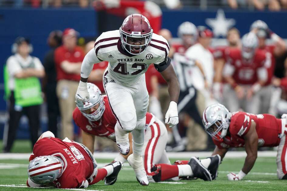 ARLINGTON, TX - SEPTEMBER 23: Texas A&M Aggies linebacker Otaro Alaka (#42) celebrates a sack during the college football game between the Arkansas Razorbacks and Texas A&M Aggies on September 23, 2017 at AT&T Stadium in Arlington, Texas. Texas A&M won the game 50-43 in overtime. (Photo by Matthew Visinsky/Icon Sportswire via Getty Images)