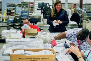 Maureen O'Brien, center, the new president and CEO of New York State Industries for the Disabled (NYSID), talks with mail processing clerks at the Center for Disability Services mail fulfillment center on Tuesday, Sept. 25, 2018, in Albany, N.Y.  (Paul Buckowski/Times Union)