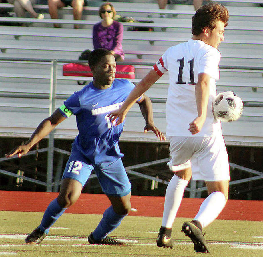 Marquette defender Kwame Ngwa, left, marks Lutheran South's Jake Reis during action in Tuesday's CYC Tourney pool game at Lutheran South in St. Louis. Marquette won 2-0. Photo: Pete Hayes | The Telegraph