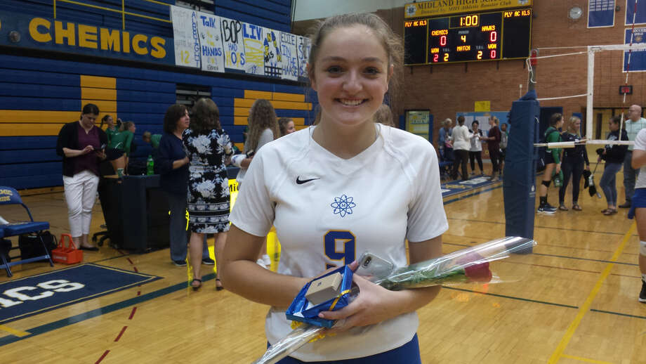 Injured Midland High senior Boppy Cripe received a warm reception from her fellow students when she was inserted briefly into Tuesday's volleyball match against Saginaw Heritage on Senior Night. Photo: Fred Kelly/fred.kelly@mdn.net