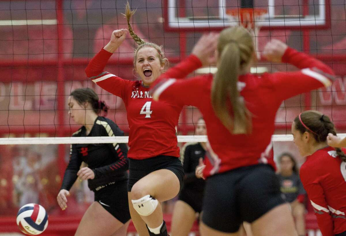 FILE PHOTO - Splendora's Shaelyn Sanders (4) reacts after scoring a point during the first set of a non-district volleyball match at Splendora High School on Friday, Aug. 17, 2018, in Splendora.