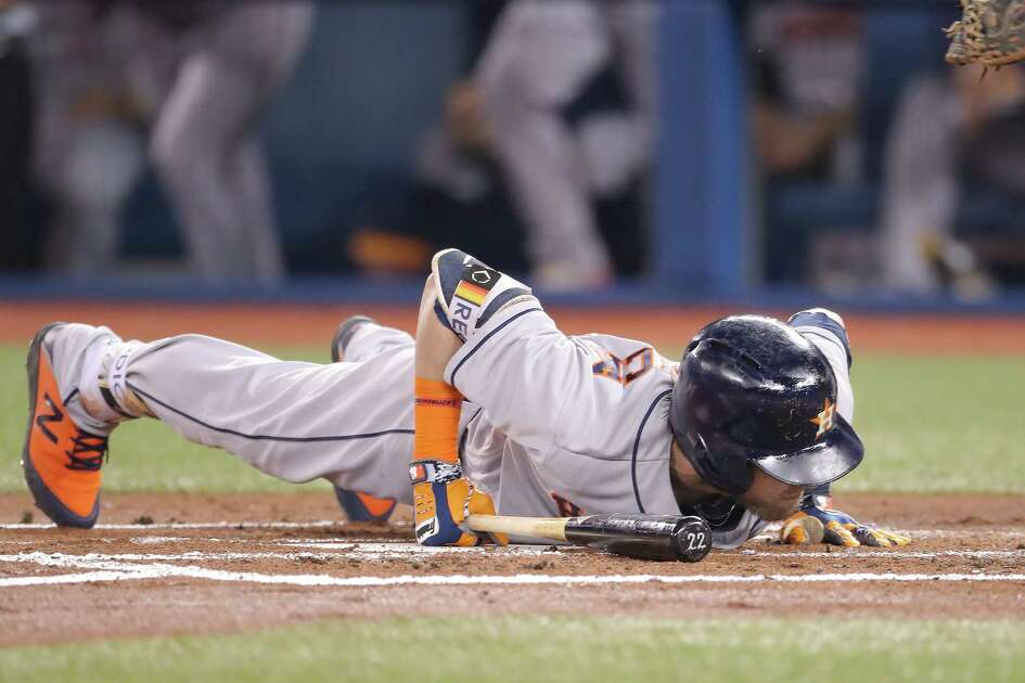 TORONTO, ON - SEPTEMBER 25: Josh Reddick #22 of the Houston Astros falls to the dirt after avoiding a high pitch in the first inning during MLB game action against the Toronto Blue Jays at Rogers Centre on September 25, 2018 in Toronto, Canada.