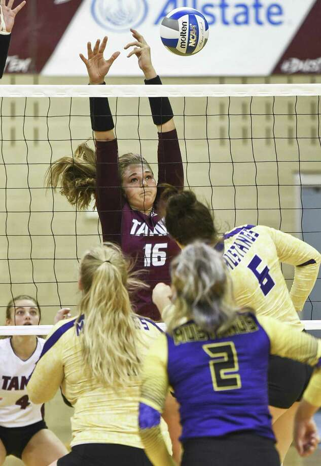 TAMIU Mackenzie Catalina defends at the net during a game against The University of Texas of the Permian Basin on Saturday, Sept. 8, 2018, at TAMIU. Photo: Danny Zaragoza /Laredo Morning Times File / Laredo Morning Times