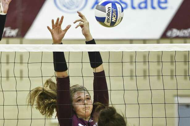 TAMIU Mackenzie Catalina defends at the net during a game against The University of Texas of the Permian Basin on Saturday, Sept. 8, 2018, at TAMIU.