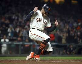 San Francisco Giants' Hunter Pence celebrates after scoring against the San Diego Padres in the seventh inning of a baseball game Tuesday, Sept. 25, 2018, in San Francisco. Pence scored on a double by Giants' Gregor Blanco. (AP Photo/Ben Margot)