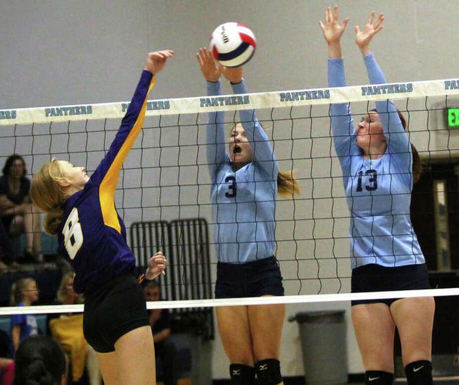 CM's Sydney Henke (left) hits through the block put up by Jersey's Alexis Liles (3) and Hannah Jones (13) during a Mississippi Valley Conference volleyball match on Tuesday night at Havens Gym in Jerseyville. Photo: Greg Shashack / The Telegraph