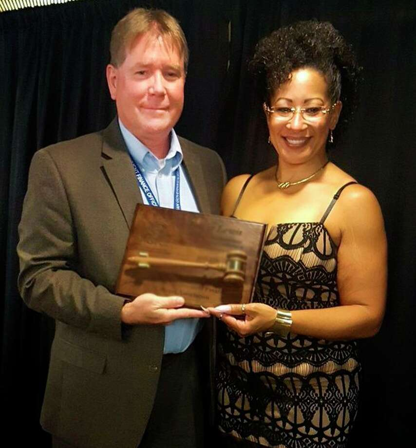City of Midland Assistant Manager Dave Keenan accepts his role as president of the Michigan Government Finance Officers Association from outgoing president Tamar Lewis. (Photo provided)