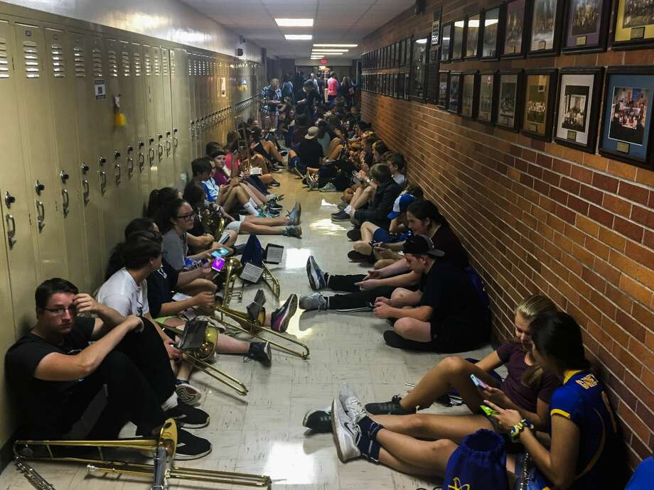 Midland High School students sit in the hallway while their after-school activities are interrupted due to a tornado warning on Tuesday, Sept. 25, 2018. (Katy Kildee/kkildee@mdn.net) Photo: (Katy Kildee/kkildee@mdn.net)