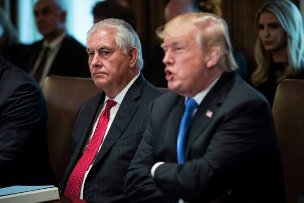 Secretary of State Rex Tillerson, left, listens as President Trump speaks during a Cabinet meeting at the White House on Dec. 20, 2017.