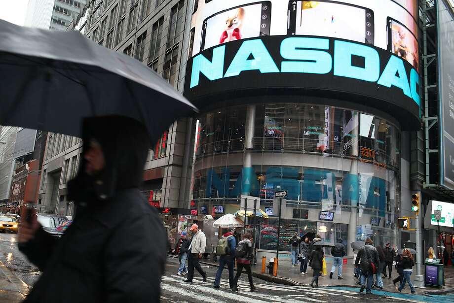 A further drop in the tech-heavy Nasdaq index could exacerbate a slowdown. Photo: Spencer Platt, ST