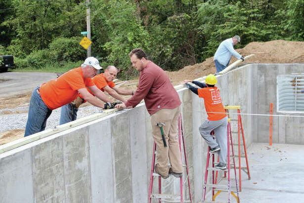 A crew works on the foundation of Habitat for Humanity's latest project.