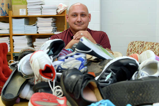 Paul Trevino, principal at Silsbee High School, with some of the shoes that have been donated to the school's fund for students in need. The fund helps provide assistance for students whose families have financial struggles. Photo taken Monday 9/24/18 Ryan Pelham/The Enterprise