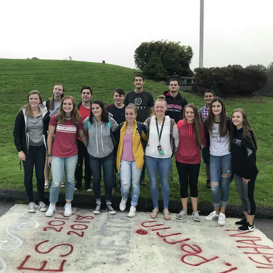 Members of the Pomperaug Christian Youth Club met Wednesday morning around the flagpole at Pomperaug High School to pray for their community as part of the annual See You at the Pole initiative. Photo: / Contributed Photo