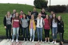 Members of the Pomperaug Christian Youth Club met Wednesday morning around the flagpole at Pomperaug High School to pray for their community as part of the annual See You at the Pole initiative.