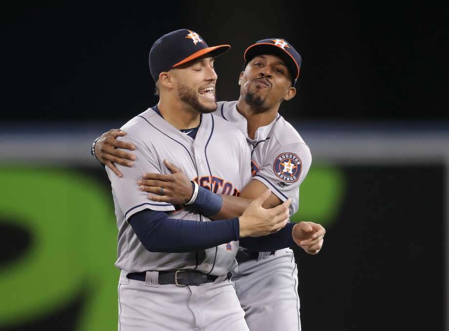 PHOTOS: How Astros players celebrated on social media after clinching the American League West title Tony Kemp #18 (R) of the Houston Astros in playful banter with George Springer #4 before the start of their MLB game against the Toronto Blue Jays at Rogers Centre on September 24, 2018 in Toronto, Canada. Browse through the photos above for a look at Astros' players social media reaction after midnight last night ... Photo: Tom Szczerbowski/Getty Images