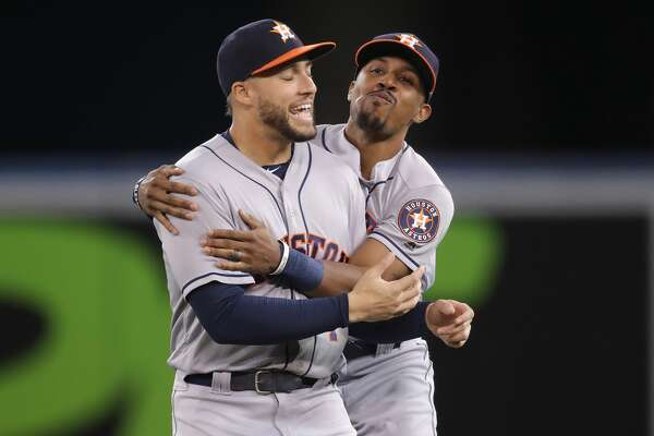 TORONTO, ON - SEPTEMBER 24: Tony Kemp #18 (R) of the Houston Astros in playful banter with George Springer #4 before the start of their MLB game against the Toronto Blue Jays at Rogers Centre on September 24, 2018 in Toronto, Canada. (Photo by Tom Szczerbowski/Getty Images)