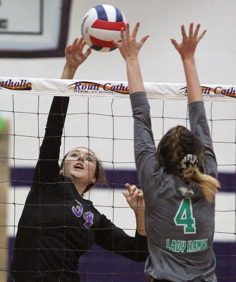 Routt's Ally Clay spikes the ball during a volleyball match against Carrollton at the Routt Dome in Jacksonville Tuesday night. Photo: Dennis Mathes | Journal-Courier