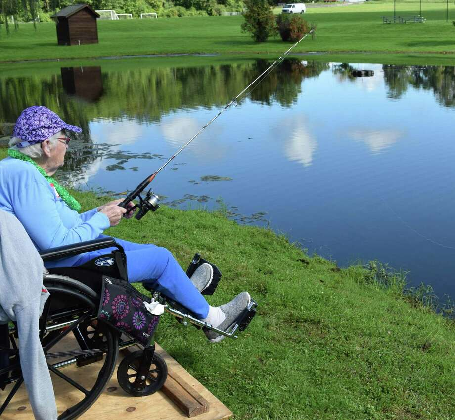 Spectrum/The annual Senior Fishing Day for local residents was held Sept. 15, 2018 at a local pond. Numerous residents of Candlewood Valley Health & Rehabilitation and Village Crest Center for Health & Rehab in New Milford. Following fishing, seniors were treated to a BBQ lunch. Above, Margaret Renzi, a resident of Village Crest, waits patiently for a bite. Photo: Deborah Rose / Hearst Connecticut Media / The News-Times  / Spectrum