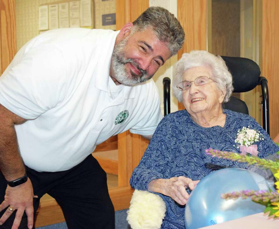 New Milford Mayor Pete Bass shares a moment with Morris after presenting her with a proclamation celebrating her birthday. Photo: Deborah Rose / Hearst Connecticut Media / The News-Times  / Spectrum