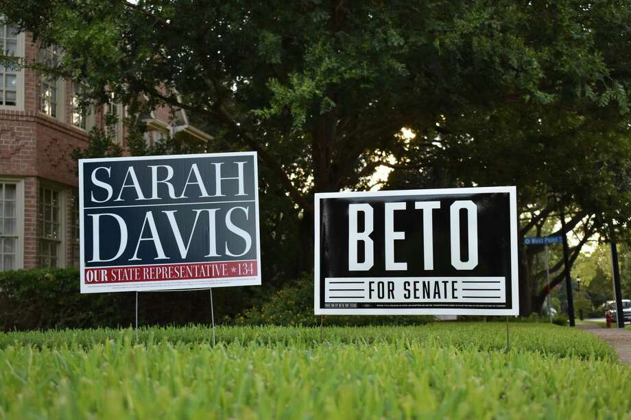 The front lawn of Jeanne and Michael Maher displays yard signs for U.S. Rep. Beto O'Rourke, an El Paso Democrat running for Senate, and Republican state Rep. Sarah Davis, who is seeking re-election in House District 134. Photo: Jasper Scherer