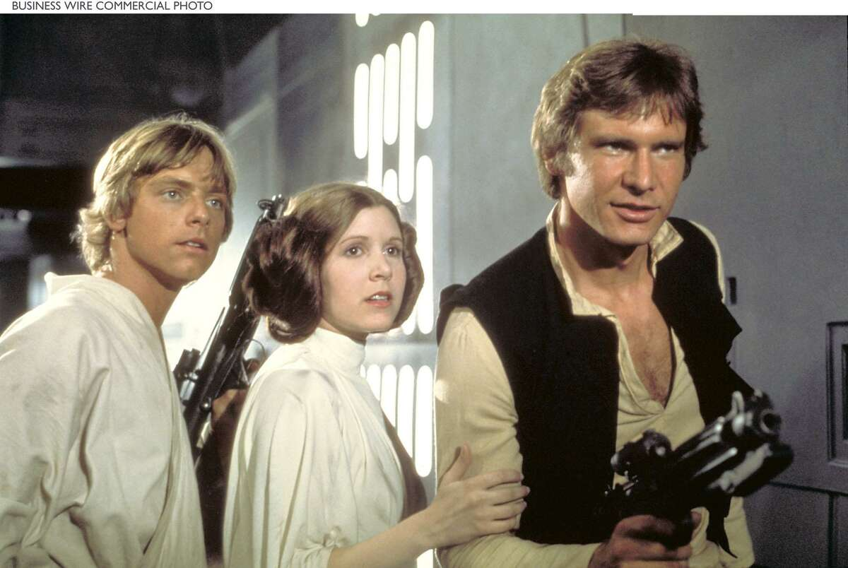 Luke Skywalker (Mark Hamill), Princess Leia (Carrie Fisher) and Han Solo (Harrison Ford) attempt to escape the clutches of Darth Vader aboard the Death Star in a scene from Star Wars: Episode IV A New Hope.